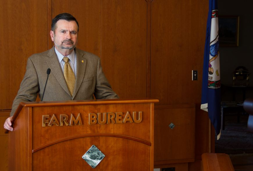 Man stands at Farm Bureau podium